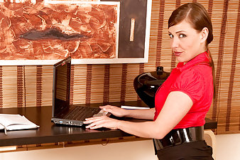 Brunette secretary takes a break to play with her Anilos pussy